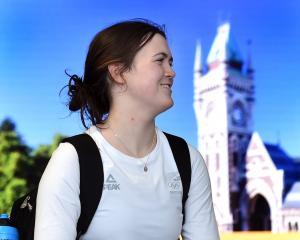 Olympic finalist Erika Fairweather arrives at Dunedin Airport yesterday. PHOTO: PETER MCINTOSH