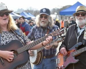 Maplewood String Band members (from left) Monica Barkman and Robbie Stevens, both of Dunedin, and...