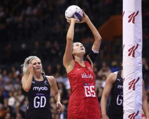 George Fisher shoots for England against the Silver Ferns last year. Photo: Getty Images