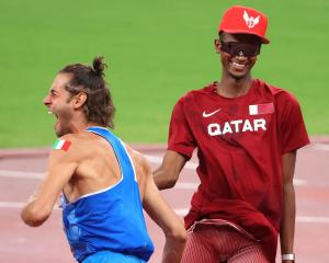Gianmarco Tamberi of Team Italy and Mutaz Essa Barshim of Team Qatar celebrate after agreeing to...