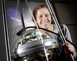 Award-winning theoretical physicist Jenni Adams with a sensor once used in the multi-national...