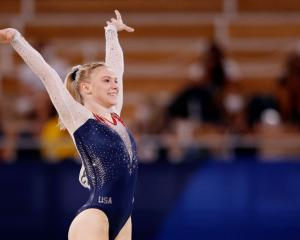 Jade Carey of the United States reacts after completing her gold medal-winning floor exercise...