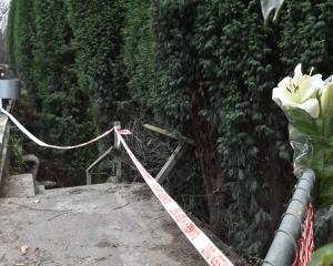 Flowers have been left at the scene of a car crash in Ravensbourne, in which a man died on...