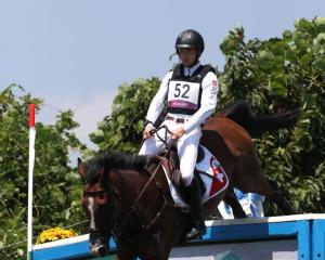 Robin Godel of Team Switzerland riding Jet Set clears a jump during the Eventing Cross Country...