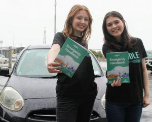 Eden Selman and Stellar Waipouri (both 17) show the guide they created to help teenagers facing...