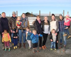 Some of the Riverstones Early Learning Centre parents and children who will be affected when it...