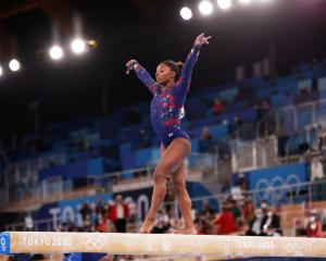 Simone Biles of Team United States competes on balance beam during Women's Qualification on day...