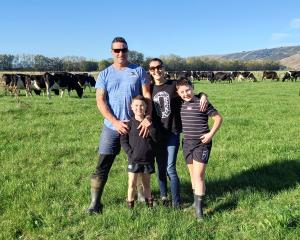 Taieri dairy farmers James and Celia Aitken, with their sons Carlos (left) and Harvey, are on...