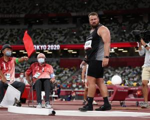Tomas Walsh reacts as the judges make a decision during the Men's Shot Put qualification at the...