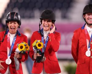 Laura Kraut, Jessica Springsteen and McLain Ward of Team United States pose with their silver...
