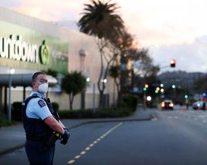 Police guard the area around Countdown Lynn mall  last evening after a terrorist attack earlier ...
