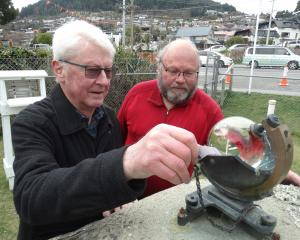 Queenstown residents Stuart Maclean, left, and Robert Taylor check the sunshine recorder at the...