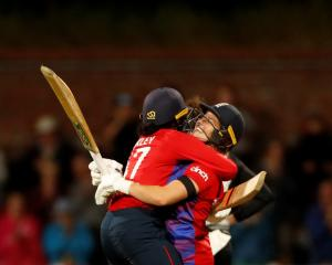 England's Sophia Dunkley and Katherine Brunt celebrate their victory. Photo: Reuters