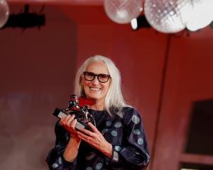 Jane Campion with her Silver Lion Award for Best Director. Photo: Reuters