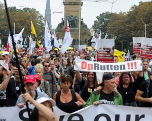 """Protesters opposed to the mandatory """"corona pass"""" march in The Hague. Photo: Reuters"""