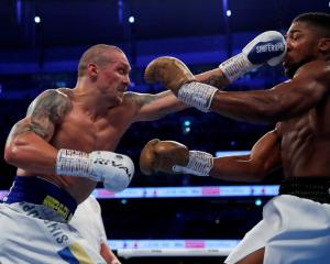 Oleksandr Usyk lands a blow on Anthony Joshua during their heavyweight bout in London. Photo:...