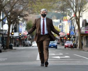Embracing a one-way future for George St is Dunedin Mayor Aaron Hawkins, approaching the Octagon...