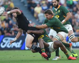 Beauden Barrett delivers an offload during the All Blacks win over South Africa on Saturday....