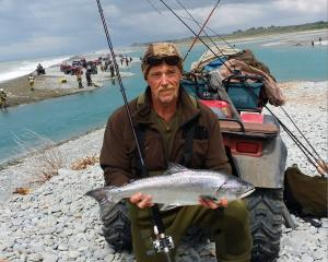 Dean Rattray, of Ashburton, holds a salmon caught in the Rangitata River. PHOTO SUPPLIED