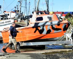 Otago Regional Council harbourmaster Steve Rushbrook inspects the vessel after it is loaded on to...