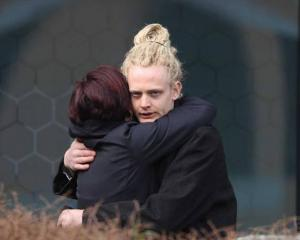Campbell Page hugs a supporter outside the Christchurch District Court yesterday. Page was...