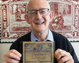 Mowbray Collectables coins, medals and banknotes director David Galt inspects an 1891 Colonial...