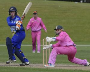 Otago Sparks batter Millie Cowan pulls a shot to the boundary as Northern Districts wicketkeeper...