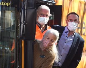 Trying Go Bus Dunedin's new electric bus are (clockwise, from front) Otago Regional Councillor...