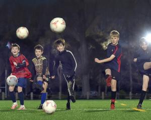 Young footballers hone their skills during a South City Royals training at Logan Park before...
