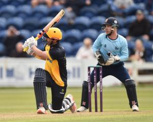 Hamish Rutherford hits for the fences during his innings of 67 for Glamorgan in the Royal London...