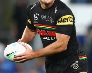 Penrith Panthers half Nathan Cleary looks for support during his team's round 25 NRL match...