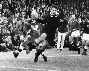 All Blacks lock Colin Meads evades a tackle during the tour of South Africa in  1970. PHOTO: THE...