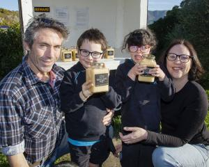 Myles, Max, Lucy and Charlotte in front of their honey stall. Photo: Geoff Sloan 