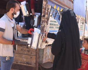 A Syrian family receive an assembled Fire for Life stove from the ReliefAid team in Syria. PHOTO:...