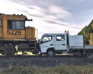 Train 932 and a hi-rail vehicle remain on the tracks after a collision in April last year. The...