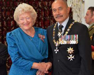 Mary Stanley-Shepherd receives her Queen's Service Medal from former Governor-General Jerry...