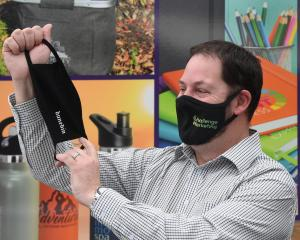 Challenge Marketing owner Adrian Hocking displays branded face masks which have been selling fast...