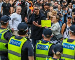 Anti-lockdown activists clash with police during a protest in Melbourne earlier this year. Photo:...