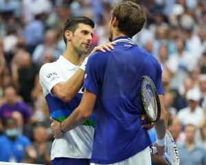 Novak Djokovic of Serbia (L) congratulates Daniil Medvedev of Russia (R) after their match in the...