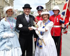 Nicole and Guenther Sumann, of Altach, Austria, are awarded the runner-up medal for best dressed...