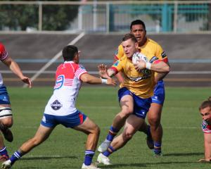 North Otago centre Hayden Todd has prop Kelepi Funaki in support as he looks to fend Horowhenua...