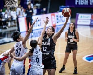 Penina Davidson floats in another basket for the Tall Ferns against South Korea at the Fiba Asia...