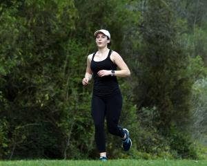 Dunedin student Pippa Dold (22) goes for a run yesterday. PHOTO: PETER MCINTOSH