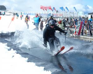 Clayton Yaxley, of Springfield, successfully negotiates the pond skim during the last day of the...