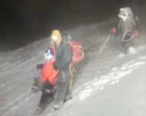 Members of Russia's Emergencies Ministry help a group of climbers stuck on Mount Elbrus on...