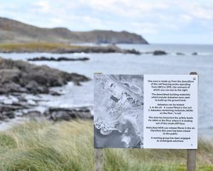 Signs at Ocean Beach in Bluff warn of the presence of asbestos.PHOTO: LAURA SMITH