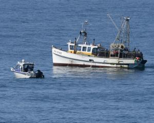 The harbour master (left) and fishing boat Echo helped tow the sunken vessel (not pictured)....