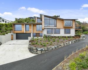 This Dunedin home was designed to capture views of St Clair beach but sit below the view line of...