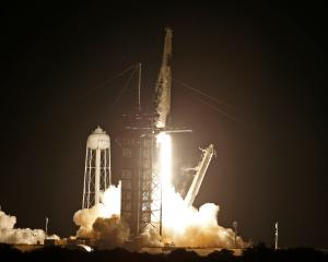 The SpaceX Falcon 9 rocket, with the Crew Dragon capsule, launched from the Kennedy Space Center...