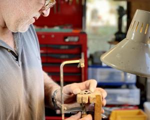 Jeweller Brendon Jaine, of Invercargill, makes a shepherd's whistle (below) from a spoon. PHOTOS:...